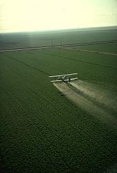 Cropduster spraying pesticides