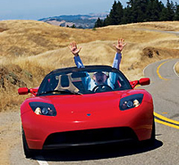 Test-driving a topless, apple-red Tesla electric Roadster