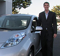 Air Force veteran Tim Goodrich with his new all-electric Nissan Leaf